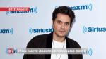 John Mayer Gets A Restraining Order